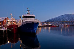The harbour in Tromso, Norway. Fishingboats at the harbour in Tromso, Norway Royalty Free Stock Photos