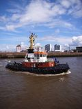 Harbour tug. Modern harbour tug passing the skyline of Bremerhaven Royalty Free Stock Photos