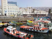 Harbour of Valparaiso in Chile. Boats fishing, scenic. colourful fishing fleet preparing for Chile 200 Stock Image