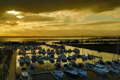 Harbour View. Marina of exquisite sailing yachts during sunset Royalty Free Stock Image