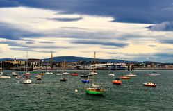 Harbour View. Boats in Dun Laoghaire Harbour Dublin Bay, Ireland with Dun Laoghaire Town in background Royalty Free Stock Photo