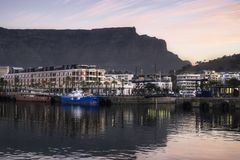 Harbour view of table mountain at sunset royalty free stock image
