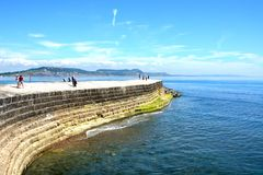 Harbour wall, Lyme Regis. Stock Photos