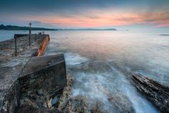 Harbour Wall Sunrise, with beautiful coloured horizon glow, Port stock photos