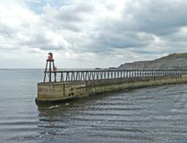 Harbour wall at Whitby. Harbour wall and light at Whitby, UK, England Royalty Free Stock Image
