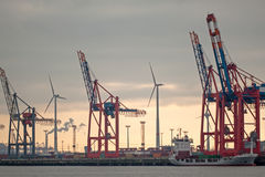 Harbour and wind power Stock Images