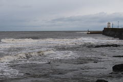 Harbour in winter. A winter harbour scene with choppy sea and heavy clouds Stock Photos