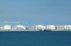 Harbour With Oil Storage Tanks Royalty Free Stock Photography