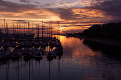 Harbour and the yachts at sunset Royalty Free Stock Photos