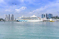 Harbourfront Centre. Cruise ship docking at Singapore harbourfront with cable car tower and reflection of the sea condominium building. Photo was taken on 17 Stock Photos