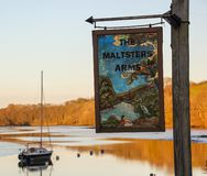 The Harbourne River, a tributary of the River Dart with a riverside pub royalty free stock image