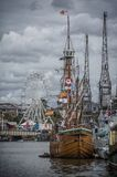 Harbourside festivities. A harbourside festival on a cloudy day Stock Image