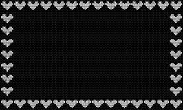Harcoal black fabric knitted background framed with knit white Stock Images