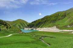 Harcum river empties into Alpine lake Kazenoyam on the border of Botlikh district of Dagestan and of the Vedeno district of the. Chechen Republic. Sunny day in stock images
