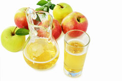 Hard Apple Cider in glass and pitcher over white Royalty Free Stock Photos