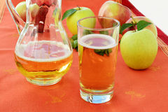Hard Apple Cider in glass and pitcher Stock Images
