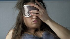 Hard awakening of a woman after excessive alcohol consumption. Headache, nausea. Hangover Syndrome.