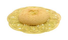 Hard biscuit on lace doily Royalty Free Stock Image