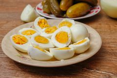 Hard boiled chicken eggs in a porcelain plate royalty free stock photography