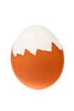 Hard boiled egg. Hard boiled egg with its shell partially removed isolated over white background Stock Photos