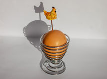 Hard boiled egg in a modern metal egg cup isolated on a white background. stock image