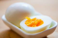 Hard boiled egg in a small dish Stock Photography