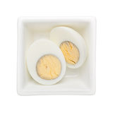Hard boiled egg. In a square bowl isolated on white background Stock Images