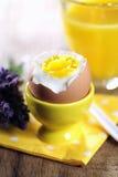Hard boiled egg on yellow napkin Stock Images