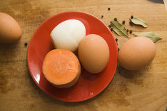 Hard boiled eggs and carrot on plate Stock Photo
