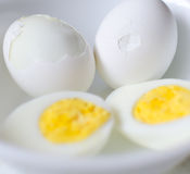 Hard Boiled Eggs With Carton. Hard boiled eggs in white bowl with carton Stock Images
