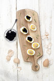 Hard boiled eggs with caviar and salmon paste Stock Photo
