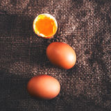 Hard boiled eggs with orange yolk in rustic style  on wooden bac Stock Photos