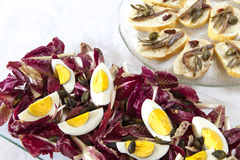 Hard-boiled eggs with organic red chicory Royalty Free Stock Photo