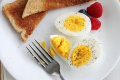 Hard boiled eggs with salt and pepper Stock Image
