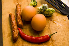 Hard boiled eggs and sausages Royalty Free Stock Images