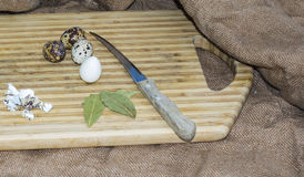 Hard boiled quail egg halves with egg shells on wooden board, photographed with natural light Selective Focus Royalty Free Stock Photography
