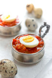Hard boiled quail eggs. With tomato sauce Royalty Free Stock Photo