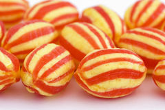 Hard boiled stripy sweets. On a white background royalty free stock photos
