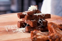 Hard bread chucks. delicious crackers sprinkled with cheese stock photos