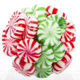 Hard candy ball. Hard red, green and white candy mints stuck in a ball Royalty Free Stock Photography