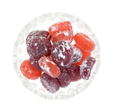 Hard candy in dish. Top view of a dish filled with powdered sugar coated fruit flavored hard candy royalty free stock photos