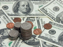 Hard cash. American dollar bills and coins royalty free stock photography