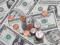 Hard cash. American dollar bills and coins stock photography