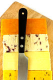 English  cheeses. A selection of English hard cheese on a cheeseboard with a knife Stock Photos