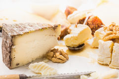 Hard cheese with nut and honey Stock Photos