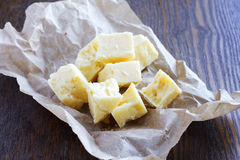 Hard cheese on slices of brokenness Royalty Free Stock Image