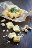 Hard cheese on slices of brokenness Royalty Free Stock Photography