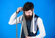 Hard choice to make. Bearded man choosing tie from luxury collection, choice concept. Salesman offering a good choice of. Design neckties. Brutal hipster making royalty free stock photos