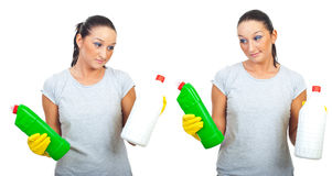 Hard choice of two cleaning products Royalty Free Stock Photos