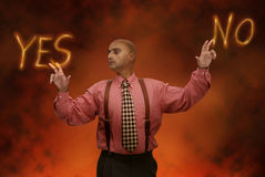 Hard choices. Businessman in hell making a choice Stock Photography